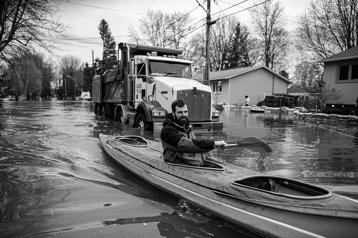 QUEBEC, CANADA - MAY 6 :  Residents of Ile Mercier south of Quebec evacuate their homes on Saturday 6, 2017. Relentless flooding hit the eastern Canadian provinces of Quebec and Ontario, the flood is considered the worst in more than 50 years causing hundreds of families to evacuate their homes and closure of major roads in the provinces. (Photo by Amru Salahuddien/Anadolu Agency/Getty Images)